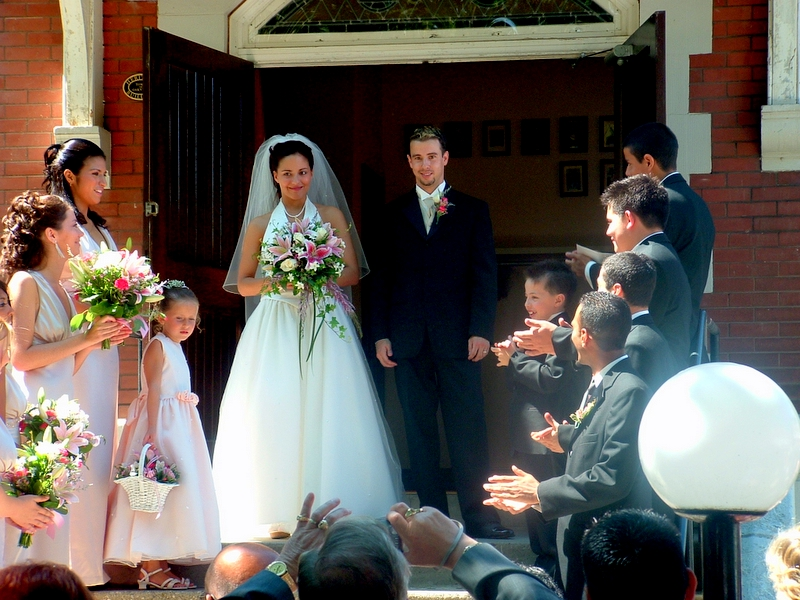 Bride and Groom exit Church.