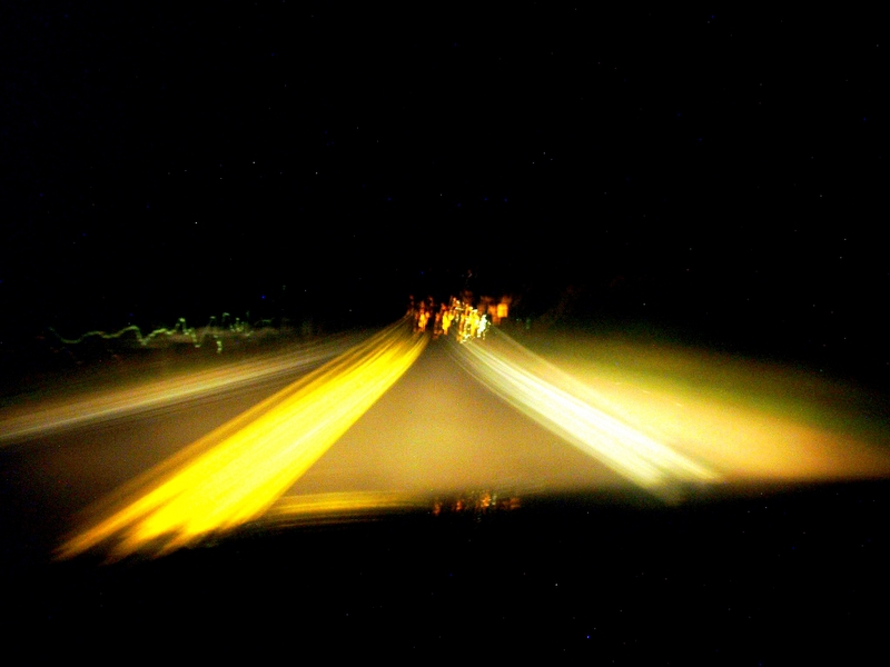 The road at night, while driving (long exposure).