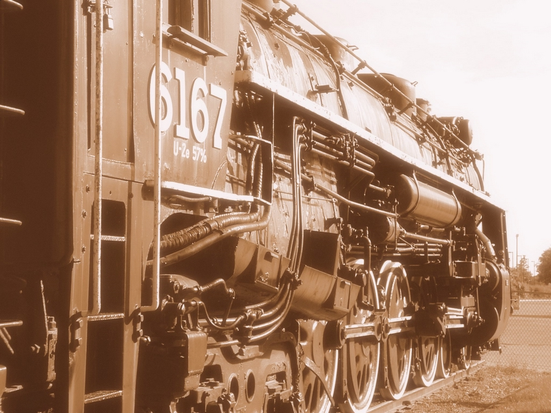 Train 6167, sepia toned, from behind.